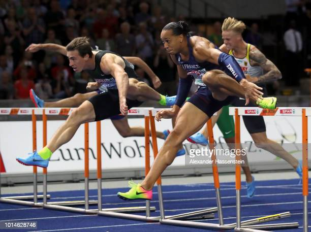 Pascal MartinotLagarde of France and Sergey Shubenkov of Authorised Neutral Athlete compete in the Men's 110m Hurdles Final during day four of the...