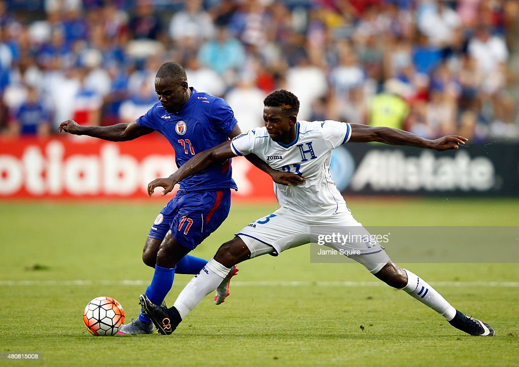 Pascal Millien #11 of Haiti and Johnny Palacios #23 of Honduras compete for the ball during the 2015 CONCACAF Gold Cup match at Sporting Park on July 13, 2015 in Kansas City, Kansas.