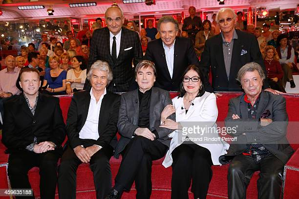 Pascal Negre Michel Drucker Jacques Revaux Martin Fontaine Daniel Guichard Serge Lama Nana Mouskouri and Herve Vilard attend the 'Vivement Dimanche'...