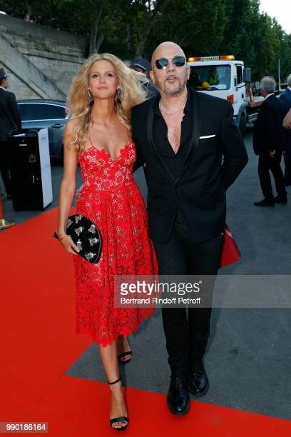 Pascal Obispo and Julie Hantson attend Line Renaud's 90th Anniversary on July 2 2018 in Paris France