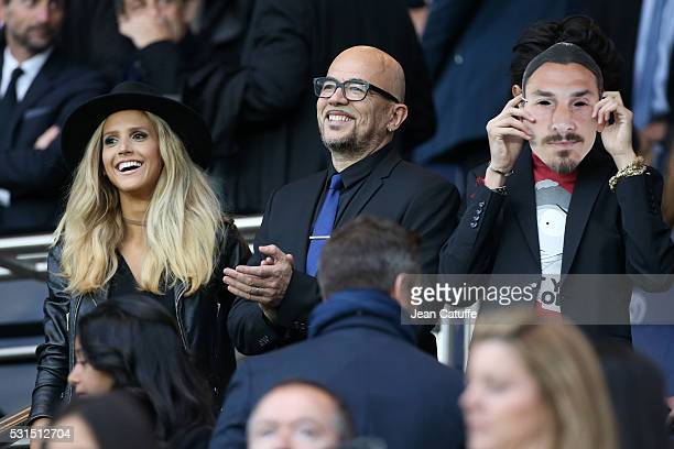 Pascal Obispo between his wife Julie Hantson and his son Sean Obispo attends the French Ligue 1 match between Paris SaintGermain and FC Nantes at...