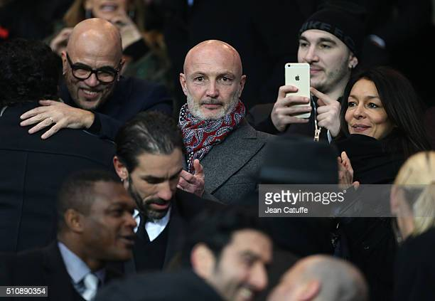 Pascal Obispo Franck Leboeuf and his girlfriend Chrislaure Nollet attend the UEFA Champions League round of 16 first leg match between Paris...