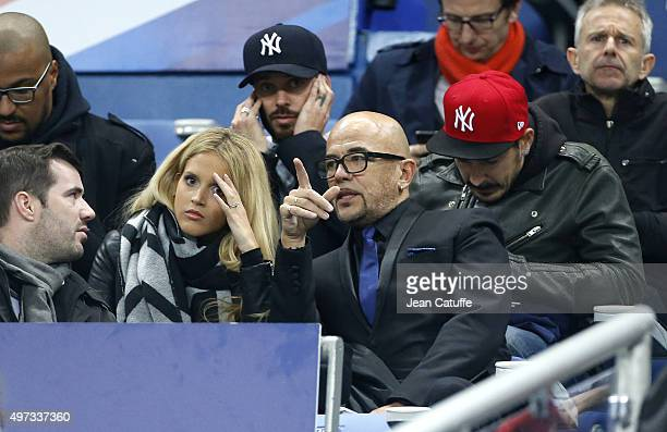 Pascal Obispo his wife Julie Hantson and above them Matt Pokora attend the international friendly match between France and Germany at Stade de France...