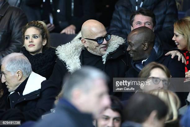 Pascal Obispo his wife Julie Hantson and Claude Makelele attend the French Ligue 1 match between Paris Saint Germain and OGC Nice at Parc des Princes...