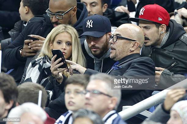Pascal Obispo his wife Julie Hantson and Matt Pokora attend the international friendly match between France and Germany at Stade de France on...