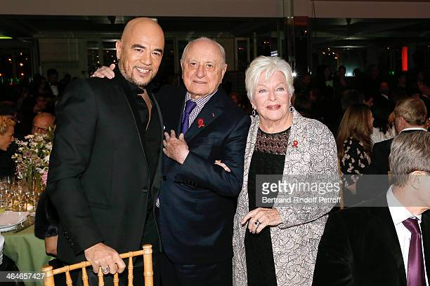 Pascal Obispo Pierre Berge and Line Renaud attend the Sidaction Gala Dinner 2014 at Pavillon d'Armenonville on January 23 2014 in Paris France