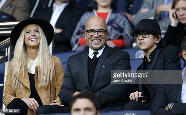 Pascal Obispo seats between his wife Julie Hantson and his son Sean Obispo during the French Ligue 1 match between Paris SaintGermain and Toulouse FC...