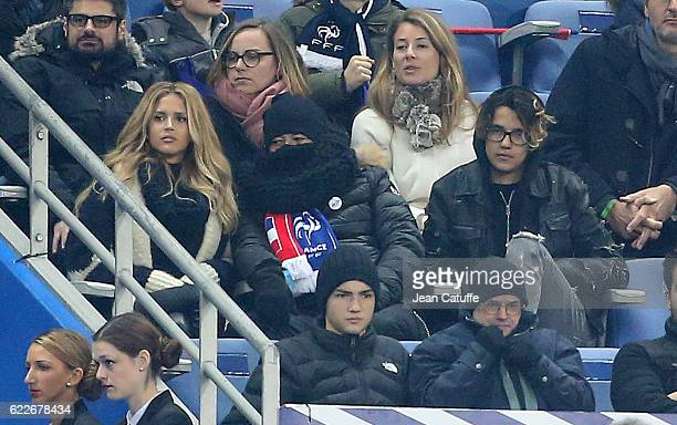 Pascal Obispo watches between his wife Julie Hantson Obispo and his son Sean Obispo the FIFA 2018 World Cup Qualifier between France and Sweden at...