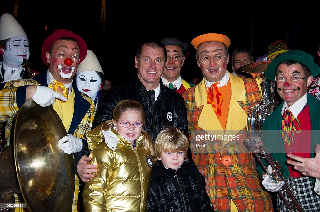 Pascal Olmeta, former French footballer and his children pose with clowns at the 35th Monte-Carlo International Circus Festival on January 22, 2011 in Monte-Carlo, Monaco.