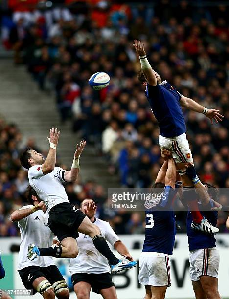 Pascal Pape of France and Cory Jane of the All Blacks contest the ball during the international test match between France and the New Zealand All...