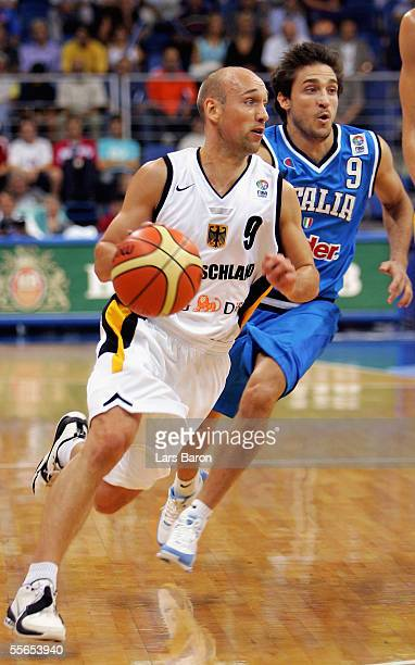Pascal Roller from Germany runs with the ball next to Gianmarco Pozzecco from Italy during the FIBA EuroBasket 2005 match between Germany and Italy...