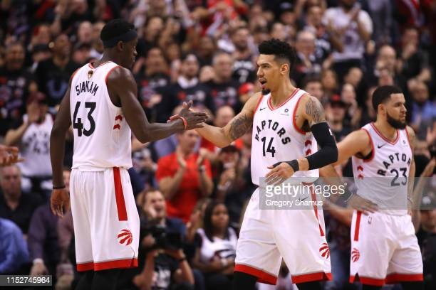 Pascal Siakam and Danny Green of the Toronto Raptors celebrate the play against the Golden State Warriors in the second half during Game One of the...