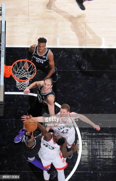 Pascal Siakam and Jakob Poeltl of the Toronto Raptors rebound against JaKarr Sampson of the Sacramento Kings on December 10 2017 at Golden 1 Center...