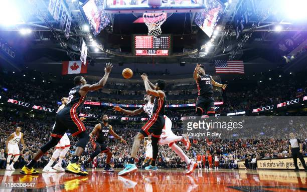Pascal Siakam of the Toronto Raptors and Derrick Jones Jr #5 of the Miami Heat battle for a rebound during the second half of an NBA game at...