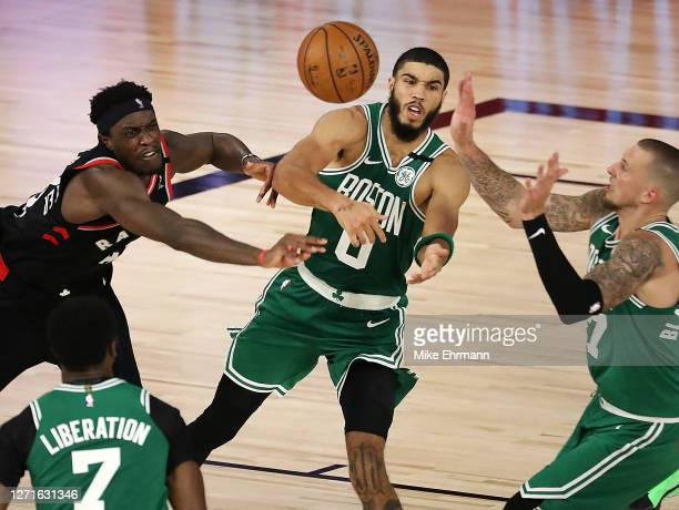 Pascal Siakam of the Toronto Raptors and Jayson Tatum of the Boston Celtics fight for a loose ball during double overtime in Game Six of the Eastern...