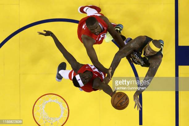 Pascal Siakam of the Toronto Raptors battles for the ball with DeMarcus Cousins of the Golden State Warriors during Game Six of the 2019 NBA Finals...
