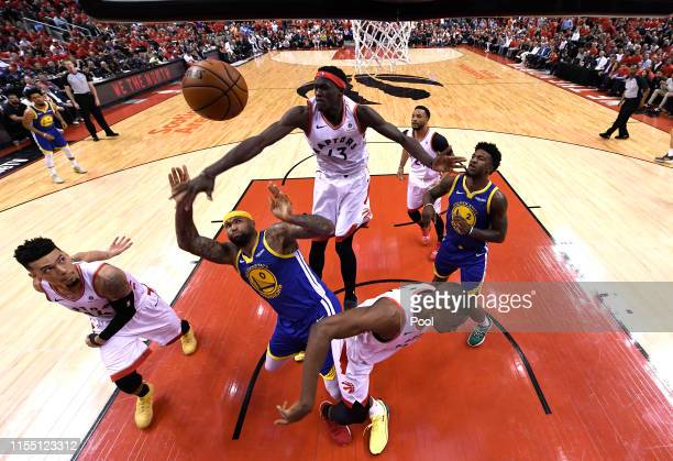 Pascal Siakam of the Toronto Raptors blocks a shot from DeMarcus Cousins of the Golden State Warriors during Game Five of the 2019 NBA Finals at...