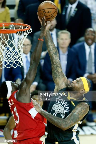 Pascal Siakam of the Toronto Raptors contests the shot by DeMarcus Cousins of the Golden State Warriors during Game Six of the NBA Finals on June 13...