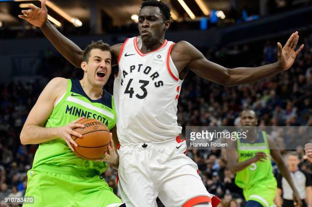 Pascal Siakam of the Toronto Raptors defends against Nemanja Bjelica of the Minnesota Timberwolves during the game on January 20 2018 at the Target...