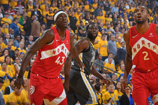 Pascal Siakam of the Toronto Raptors Draymond Green of the Golden State Warriors and Kawhi Leonard of the Toronto Raptors defend for the rebound...