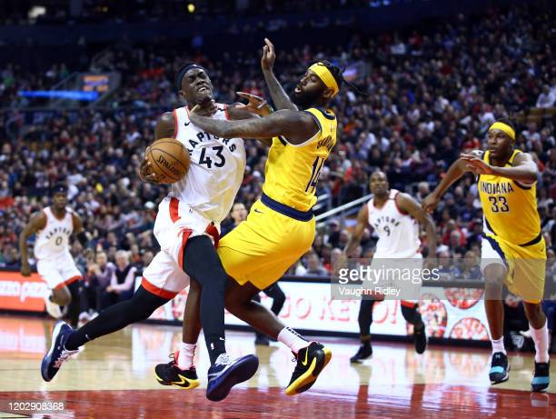 Pascal Siakam of the Toronto Raptors dribbles the ball as JaKarr Sampson of the Indiana Pacers defends during the second half of an NBA game at...