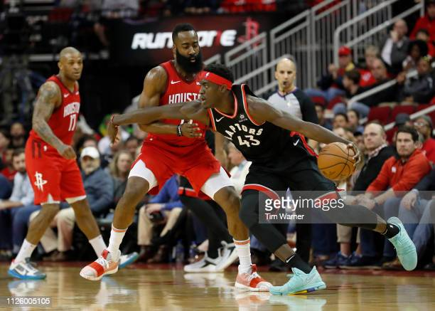 Pascal Siakam of the Toronto Raptors dribbles the ball defended by James Harden of the Houston Rockets in the first half at Toyota Center on January...