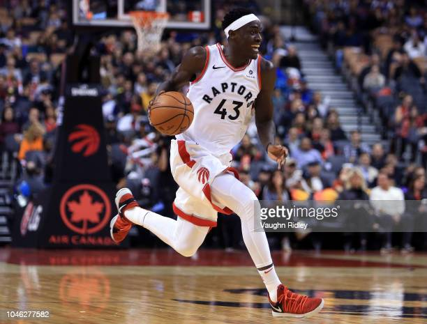 Pascal Siakam of the Toronto Raptors dribbles the ball during the second half of an NBA preseason game against of Melbourne United at Scotiabank...