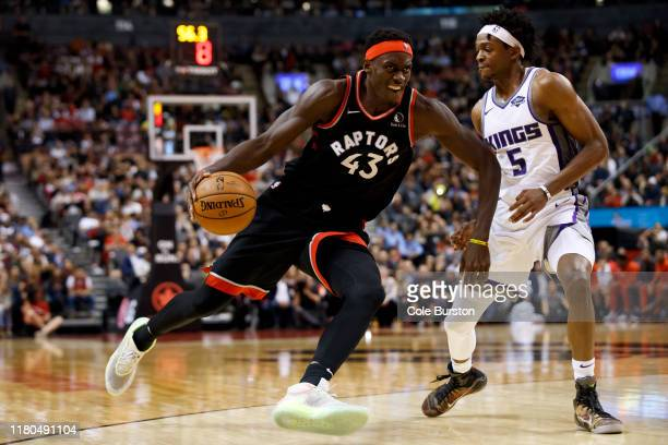 Pascal Siakam of the Toronto Raptors drives to the net on De'Aaron Fox of the Sacramento Kings during second half of their NBA game at Scotiabank...