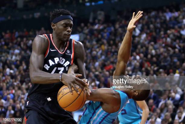 Pascal Siakam of the Toronto Raptors fouls Kemba Walker of the Charlotte Hornets as he defends during the first half of an NBA game at Scotiabank...