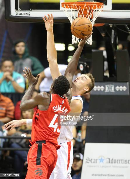 Pascal Siakam of the Toronto Raptors grabs a rebound over Sam Dekker of the Los Angeles Clippers during the third quarter at the Stan Sheriff Center...
