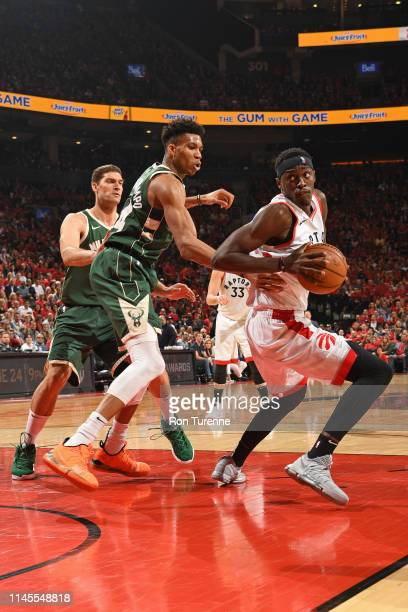 Pascal Siakam of the Toronto Raptors handles the ball against the Milwaukee Bucks during Game Four of the Eastern Conference Finals on May 21 2019 at...