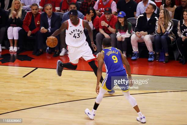Pascal Siakam of the Toronto Raptors is defended by Andre Iguodala of the Golden State Warriors in the first half during Game Two of the 2019 NBA...