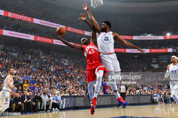 Pascal Siakam of the Toronto Raptors shoots the ball against Joel Embiid of the Philadelphia 76ers during Game Four of the Eastern Conference...