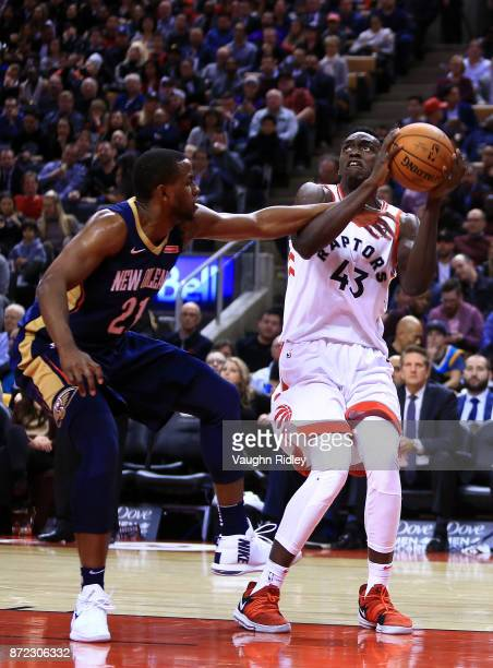Pascal Siakam of the Toronto Raptors shoots the ball as Darius Miller of the New Orleans Pelicans defends during the second half of an NBA game at...