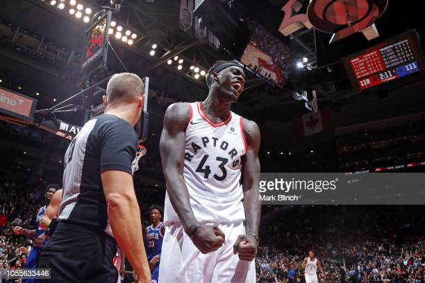 Pascal Siakam of the Toronto Raptors yells and flexes during the game against the Philadelphia 76ers on October 30 2018 at Soctiabank Arena in...