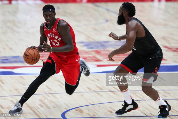 Pascal Siakam of Toronto Raptors handles the ball against James Harden of Houston Rockets during the preseason game between Houston Rockets and...