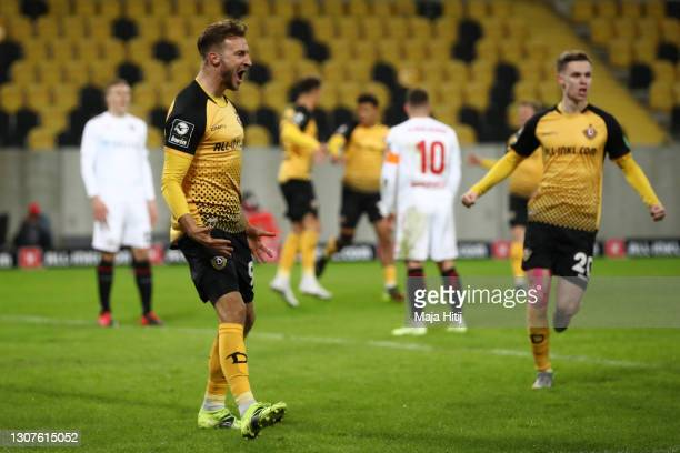 Pascal Sohm of Dynamo Dresden celebrates after scoring his teams first goal during the 3. Liga match between Dynamo Dresden and SV Wehen Wiesbaden at...