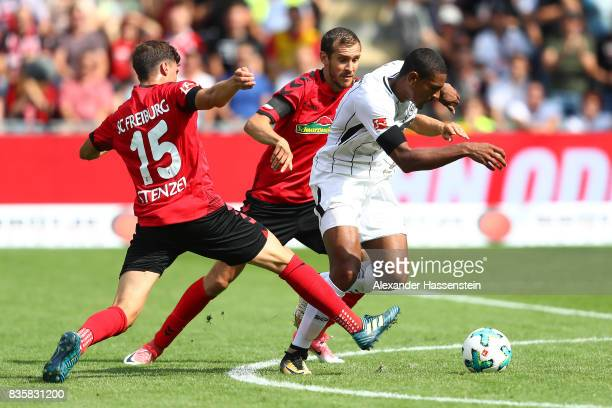 Pascal Stenzel of FC Freiburg Sebastien Haller of Frankfurt and Julian Schusterof FC Freiburg during the Bundesliga match between SportClub Freiburg...