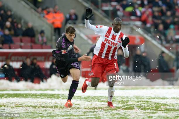 Pascal Stenzel of Freiburg and Sehrou Guirassy of Koeln battle for the ball during the Bundesliga match between 1 FC Koeln and SportClub Freiburg at...