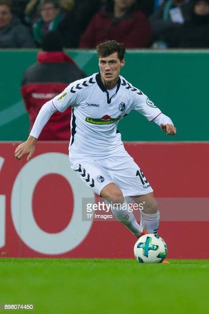 Pascal Stenzel of Freiburg controls the ball during the DFB Cup match between Werder Bremen and SC Freiburg at Weserstadion on December 20 2017 in...
