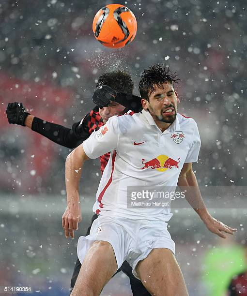 Pascal Stenzel of Freiburg jumps for a header with Rani Khedira of RB Leipzig during the Second Bundesliga match between SC Freiburg and RB Leipzig...