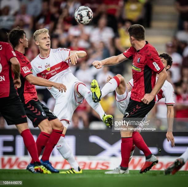 Pascal Stenzel of Freiburg Timo Baumgartl of Stuttgart Benjamin Pavard of Stuttgart and Dominique Heintz of Freiburg compete for the ball during the...