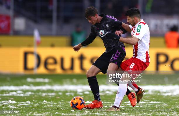 Pascal Stenzel of SC Freiburg and Milos Jojic of FC Koeln battle for the ball during the Bundesliga match between 1 FC Koeln and SportClub Freiburg...