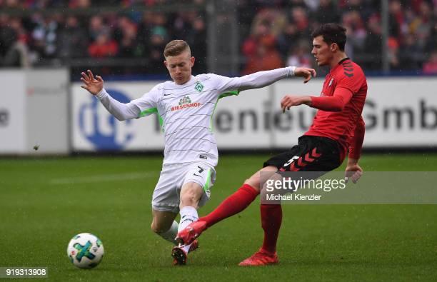 Pascal Stenzel of SC Freiburg challenges Florian Kainz of SV Werder Bremen during the Bundesliga match between SportClub Freiburg and SV Werder...