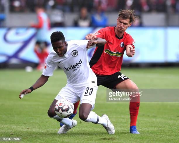 Pascal Stenzel of SC Freiburg challenges Talb Tawatha of Eintracht Frankfurt during the Bundesliga match between Sport Club Freiburg and Eintracht...