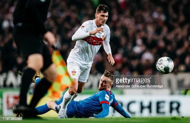 Pascal Stenzel of Stuttgart in action against Tobias Mohr of Heidenheim during the Second Bundesliga match between VfB Stuttgart and 1. FC Heidenheim...