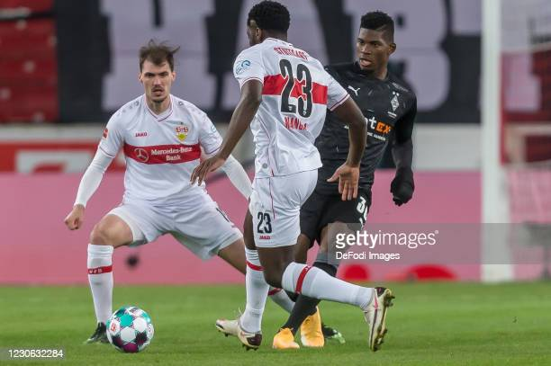 Pascal Stenzel of VfB Stuttgart, Orel Mangala of VfB Stuttgart and Breel Embolo of Borussia Moenchengladbach battle for the ball during the...