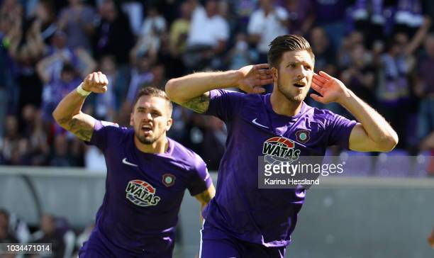 Pascal Testroet and Dennis Kempe of Aue celebrate the opening goal during the second Bundesliga match between FC Erzgebirge Aue and FC StPauli at...