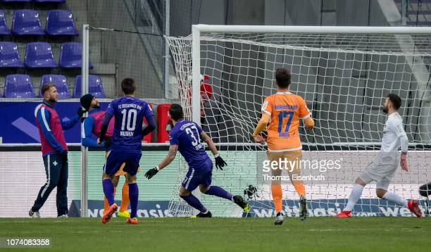 Pascal Testroet of Aue scores his team's second goal past goalkeeper Daniel Heuer Fernandes of Darmstadt during the Second Bundesliga match between...