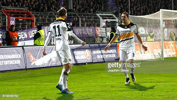 Pascal Testroet of Dresden celebrates scoring his team's first goal with teammate Justin Eilers during the third league match between VfL Osnabrueck...